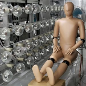 Thermal manikin sitting next to a bunch of lightbulbs