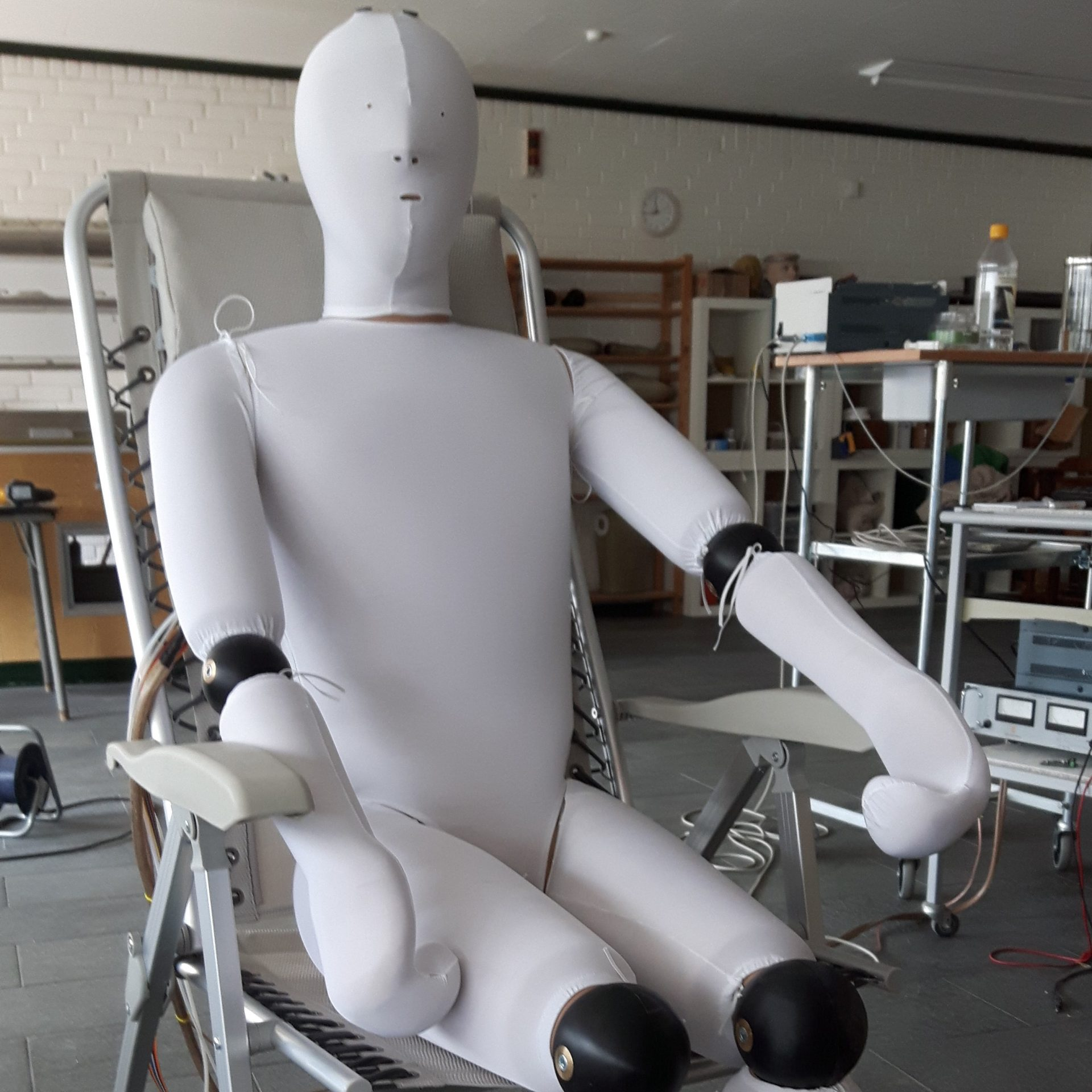 Sweating manikin sitting in chair