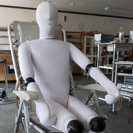 A sweating manikin in a chair
